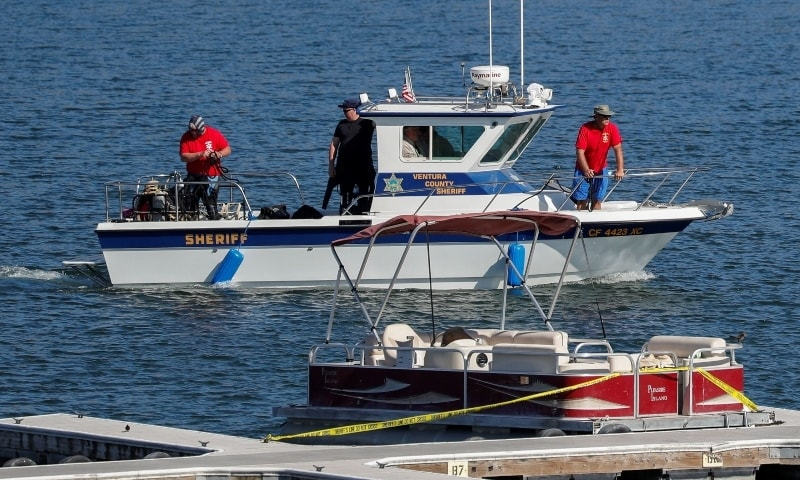 A boat from the Ventura County Sheriff's department sails near the boat that actor Naya Rivera was using when she went missing, on Lake Piru, California, July 9. — Reuters/File
