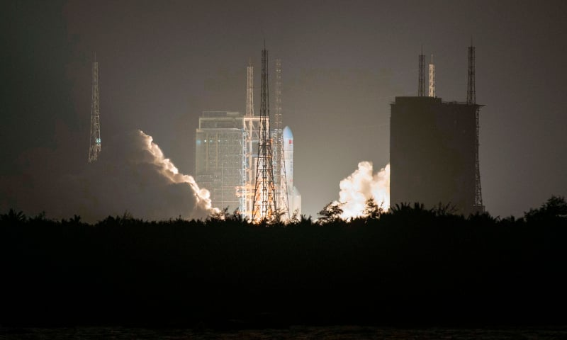 This file photo taken on December 27, 2019 shows China's heavy-lift Long March 5 rocket blasts off from its launch centre in Wenchang, south China's Hainan province. — AFP