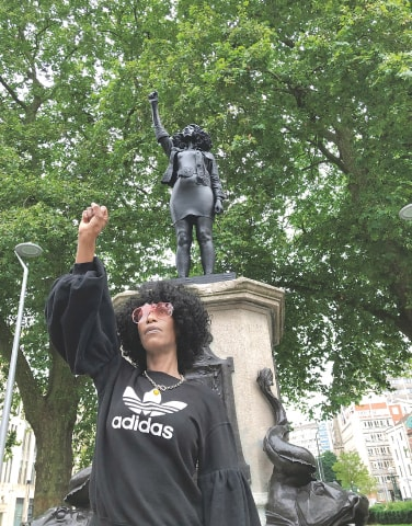 BRISTOL: Jen Reid poses on Wednesday in front of her sculpture titled 'A Surge of Power', which replaced the statue of slave trader Edward Colston.—Reuters
