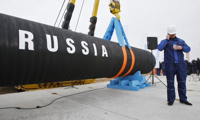 In this April 9, 2010 file photo, a Russian construction worker speaks on a mobile phone in Portovaya Bay some 170 kms  north-west from St. Petersburg, Russia, during a ceremony marking the start of Nord Stream pipeline construction. — AP