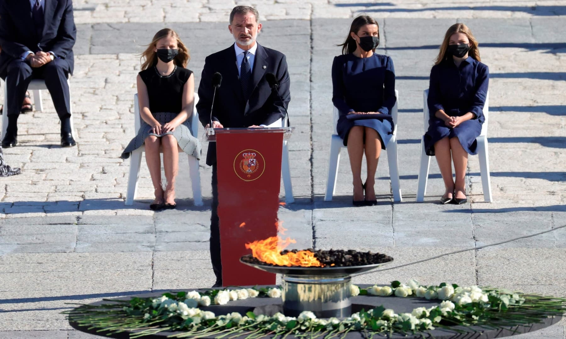 King Felipe VI of Spain (2L) delivers a speech during a state ceremony to honour the 28,400 victims of the coronavirus crisis as well as those public servants who have been fighting on the front line against the pandemic in Spain. — AFP