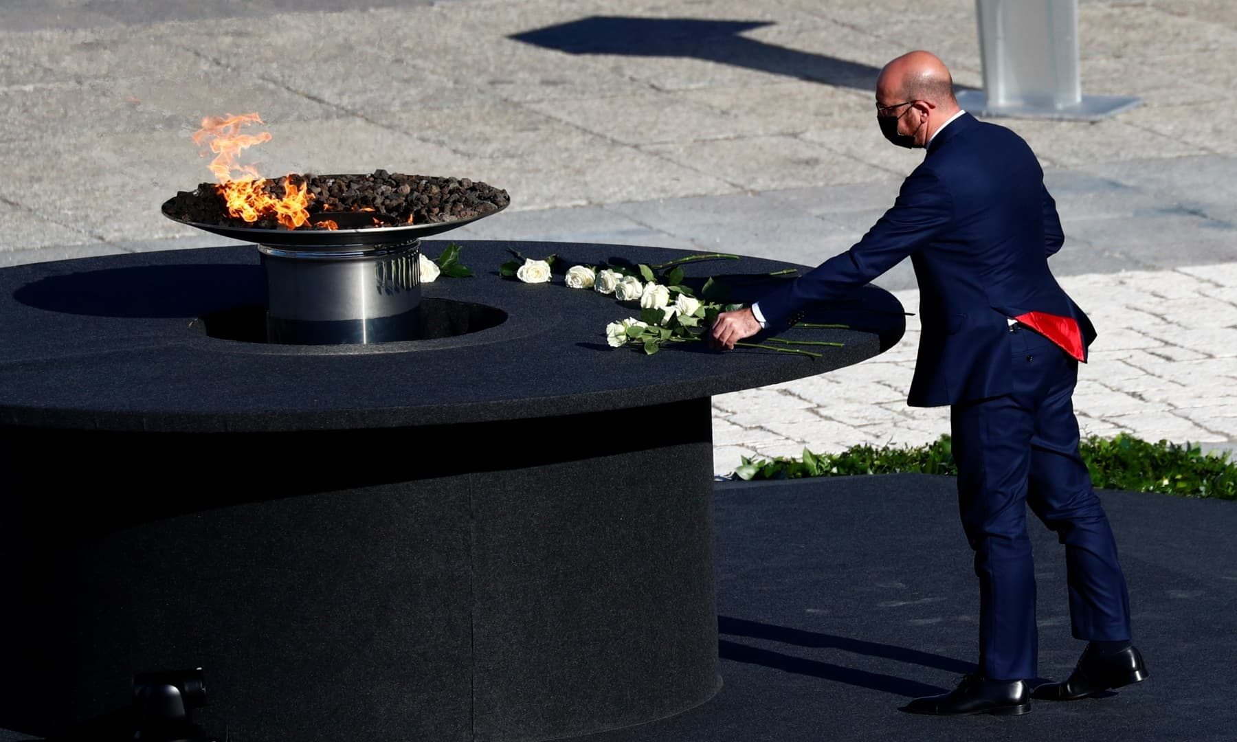 European Council President Charles Michel places flowers during a state tribute in memory of Spain's Covid-19 victims. — Reuters