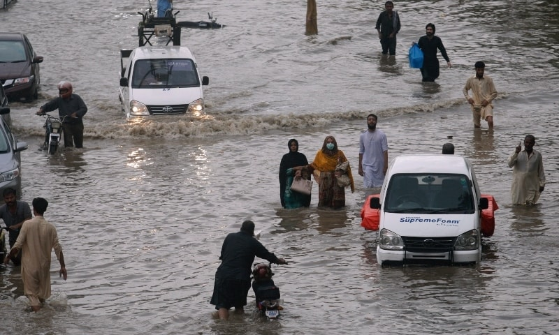 Flooded roads, power outages and traffic jams: Heavy rain wreaks havoc in Karachi