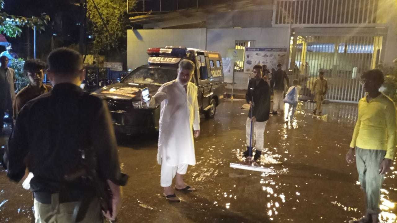 A police team drains rainwater outside JPMC. — Photo: SHO Saddar