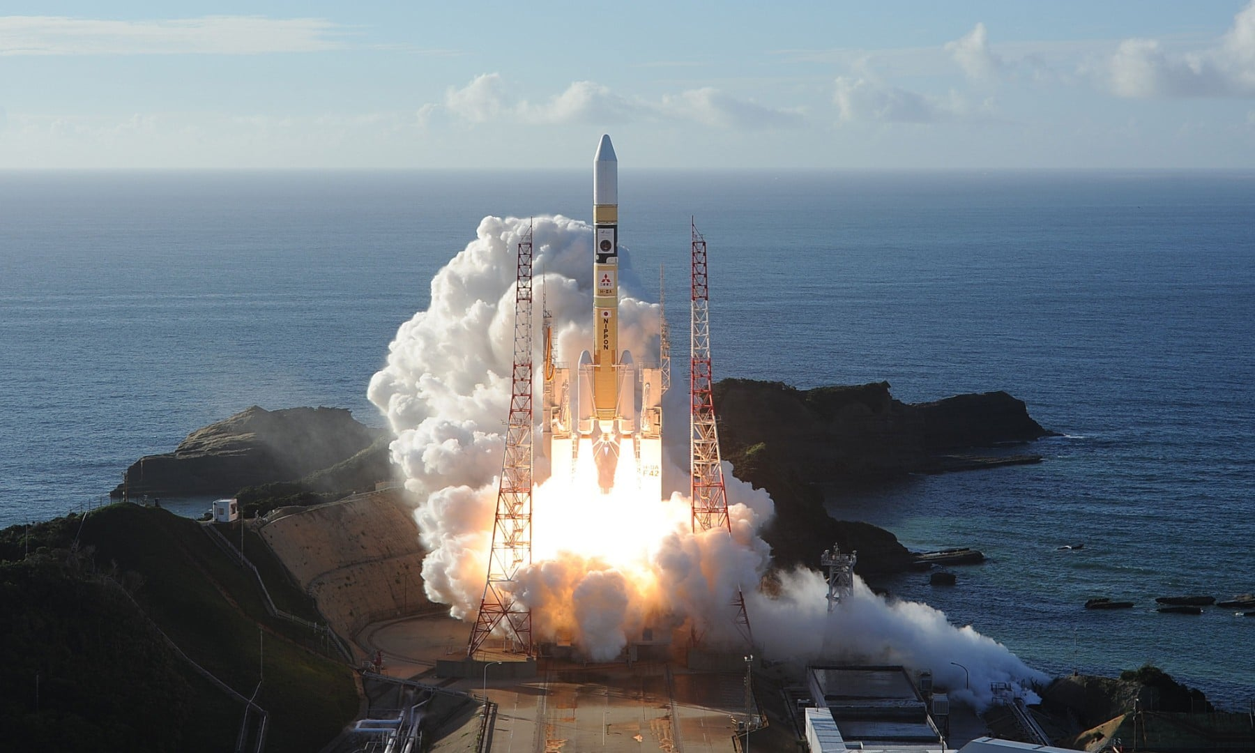 In this handout photograph taken and released on July 20, an H-2A rocket carrying the Hope Probe blasts off from Tanegashima Space Centre in southwestern Japan. — AFP