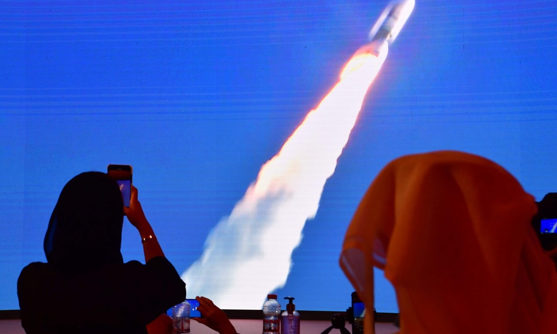 "A picture taken on July 19, hows a screen broadcasting the launch of the ""Hope"" Mars probe at the Mohammed Bin Rashid Space Centre in Dubai. — AFP"