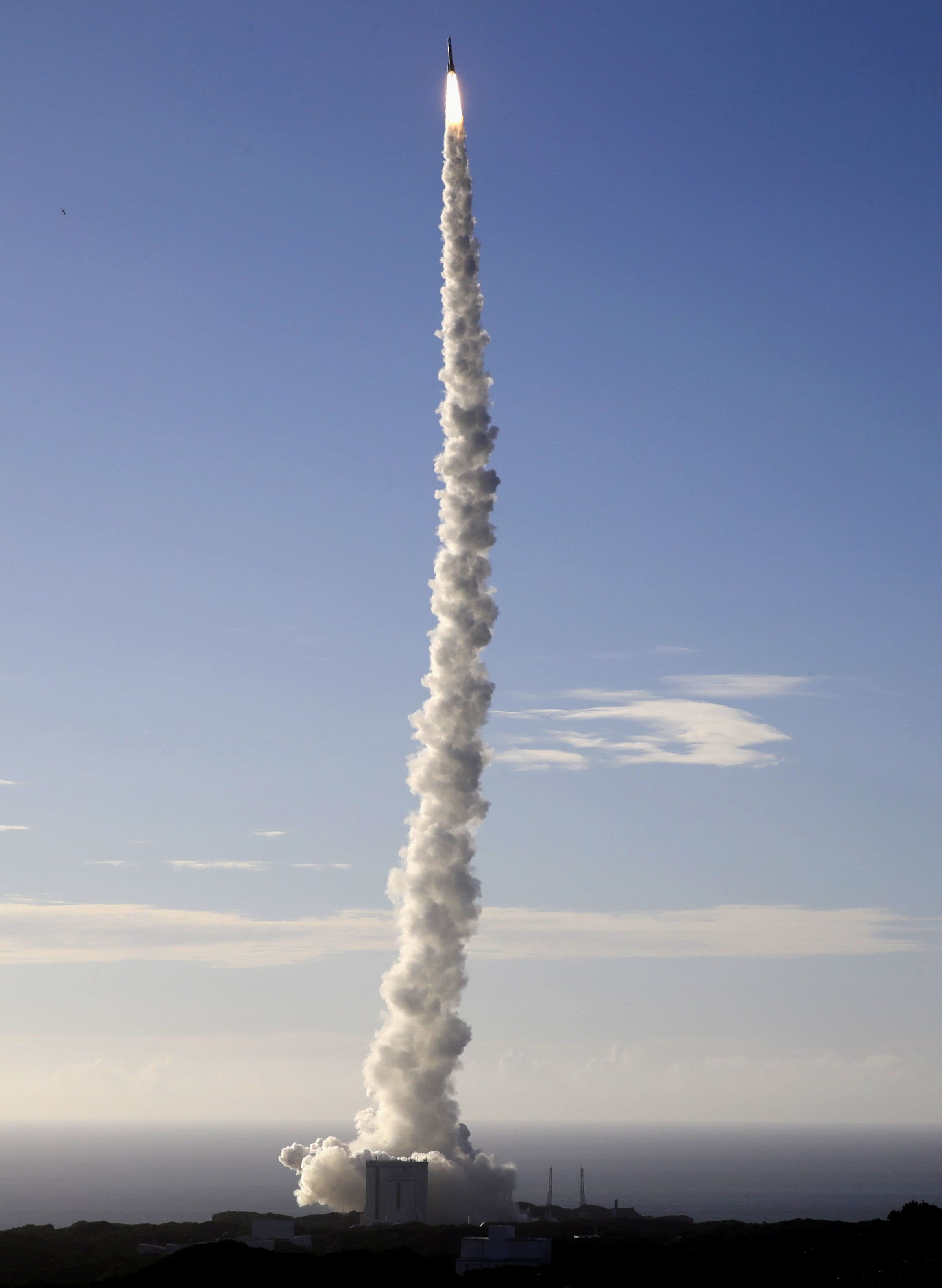 An H-2A rocket carrying the Hope Probe, rises into the air after blasting off from the launching pad at Tanegashima Space Center on the southwestern island of Tanegashima, Japan. — Reuters