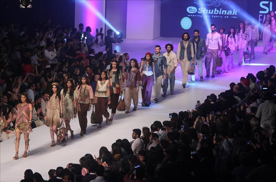 Large crowd has become an inevitable reality at any local fashion week, wheedling their way in through passes given out by sponsors — Photo by Rana Irfan Ali / Anadolu Agency