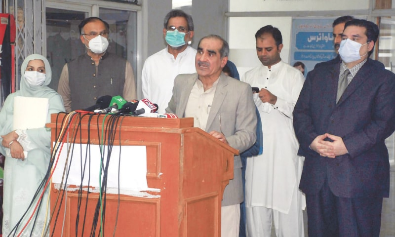 PML-N leader Khawaja Saad Rafiq addresses the press conference as other leaders of his party look on.—Online