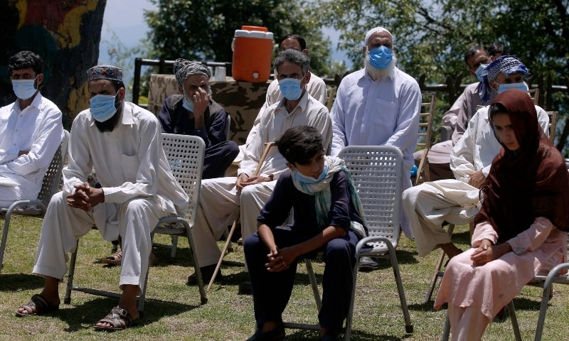 Kashmiri villagers wait to interact with journalists in Chiri Kot sector near the Line of Control on July 22. — AP