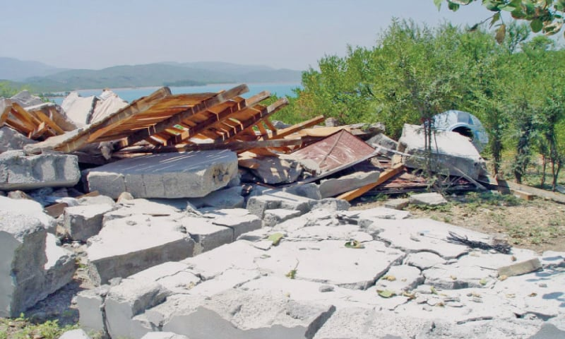 Demolished structure of a farmhouse built illegally on Khanpur dam's property. — Dawn