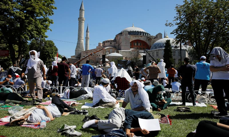 People wait for the beginning of Friday prayers outside Hagia Sophia Grand Mosque, for the first time after it was once again declared a mosque after 86 years, in Istanbul, Turkey on July 24, 2020. — Reuters