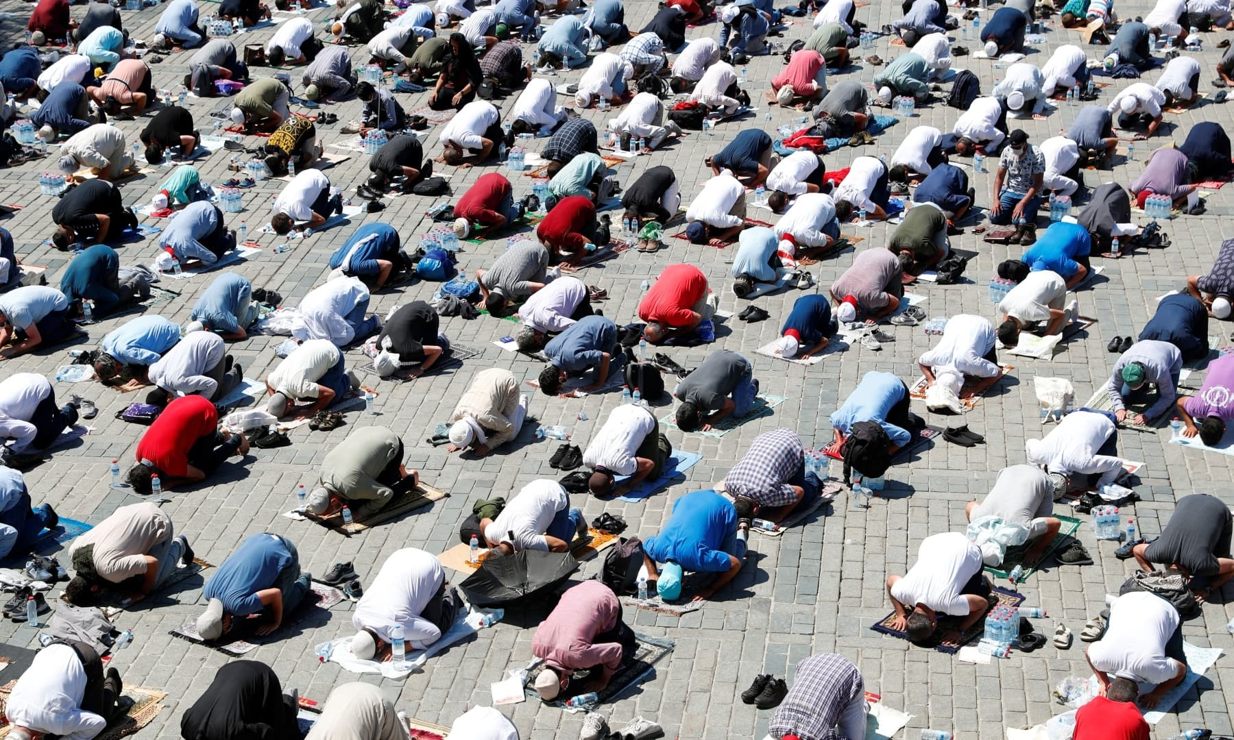 Muslims attend Friday prayers outside Hagia Sophia Grand Mosque. — Reuters