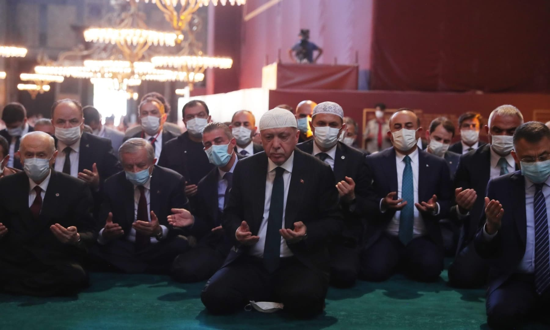Turkey's President Tayyip Erdogan (C) and invited guests attend Friday prayers at Hagia Sophia Grand Mosque during the official opening ceremony of Hagia Sophia in Istanbul. — AFP/TURKISH PRESIDENTIAL PRESS SERVICE