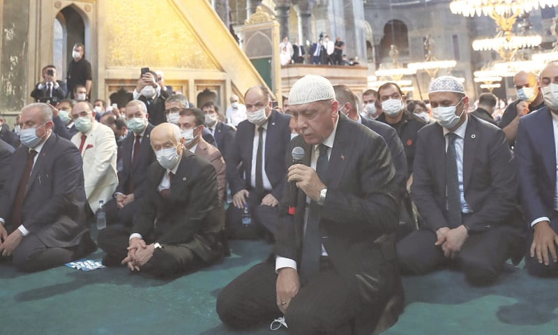 ISTANBUL: Turkey's President Recep Tayyip Erdogan recites from the Holy Quran during Friday congregation in Hagia Sophia on Friday.—AP