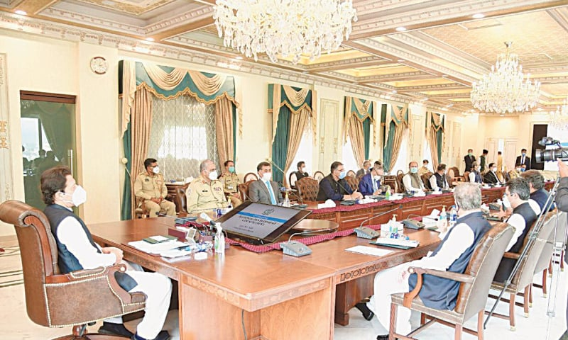 ISLAMABAD: Prime Minister Imran Khan presides over a meeting of the National Development Council on Friday.—Dawn