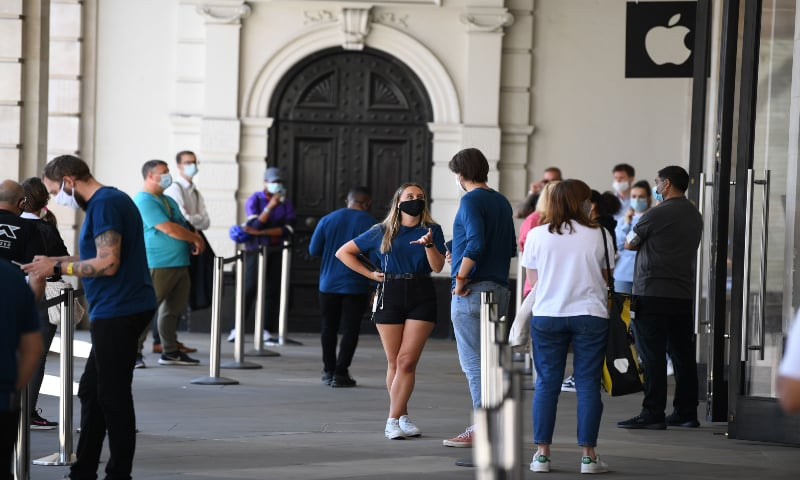Shoppers wear face masks in Covent Garden, central London on July 24, 2020, as lockdown restrictions continue to be eased during the Covid-19 pandemic. — AFP