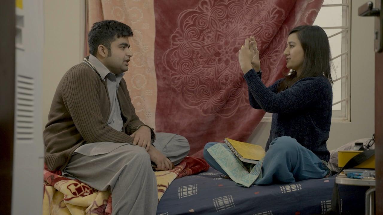 Virk's wife Iram takes a photo of him | Courtesy Witness — Al Jazeera