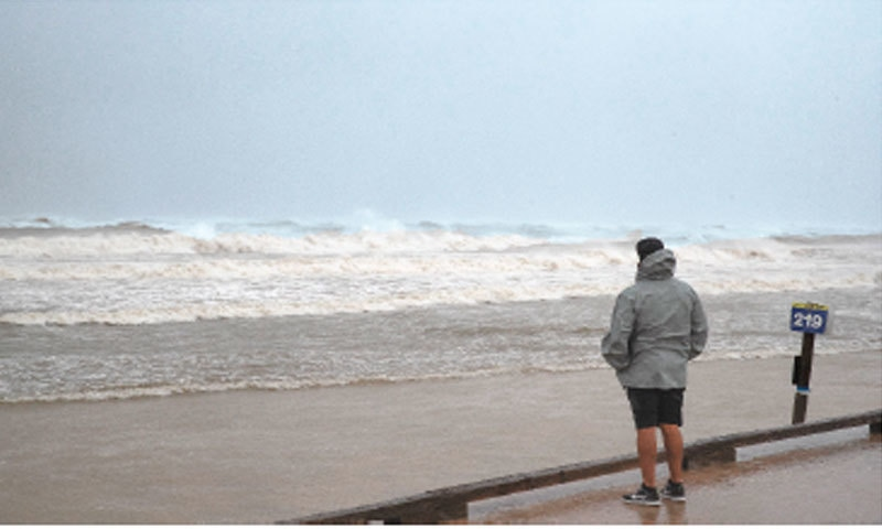A MAN stands on the seawall at Whitecap beach watches the waves as Hurricane Hanna approaches land on Saturday in Corpus Christi, Texas.—AP
