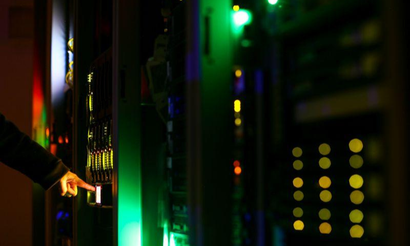 A man poses inside a server room at an IT company in this June 19, 2017 illustration photo. — Reuters/File