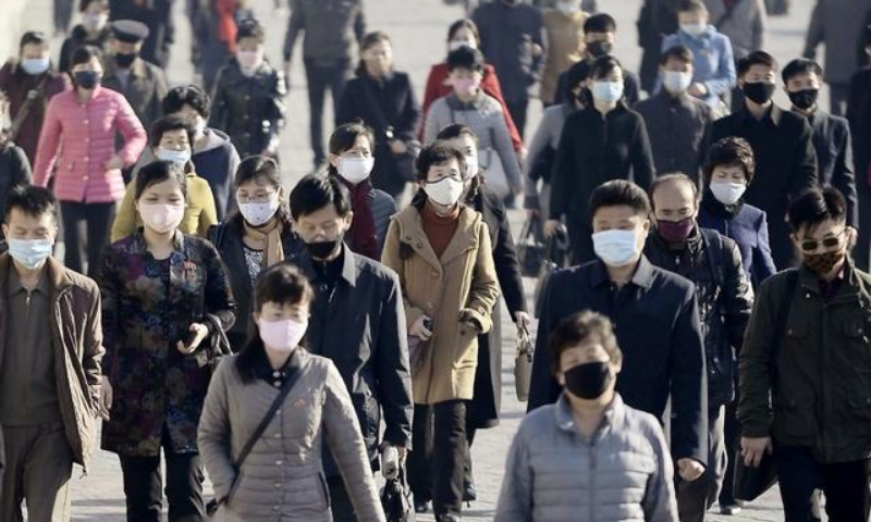 In this March 2020 file photo, people wearing protective face masks commute amid concerns of the coronavirus in Pyongyang, North Korea. — Reuters