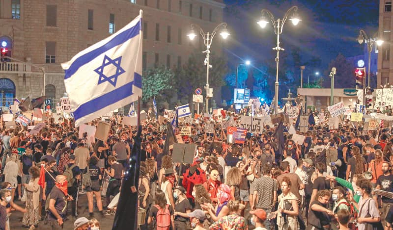 Jerusalem: Protesters gather for a demonstration against the Israeli government near the prime minister's residence.—AFP