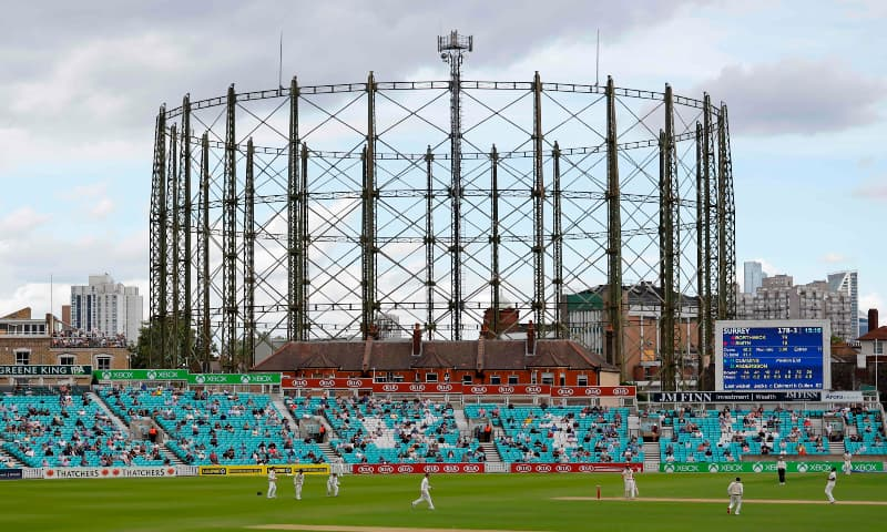 Spectators sit socially distanced leaving spaces between groups as a precaution against the spread of the novel coronavirus as they watch the friendly county cricket match between Surrey and Middlesex at the Oval in London on July 26, 2020.