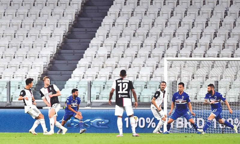 TURIN: Juventus' Cristiano Ronaldo (L) scores during the Serie A match against Sampdoria at the Allianz Stadium. — Reuters