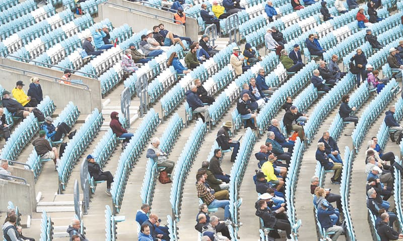 LONDON: Fans are seen sitting apart in the stands during a friendly match between Surrey and Middlesex at The Oval on Monday. — AP