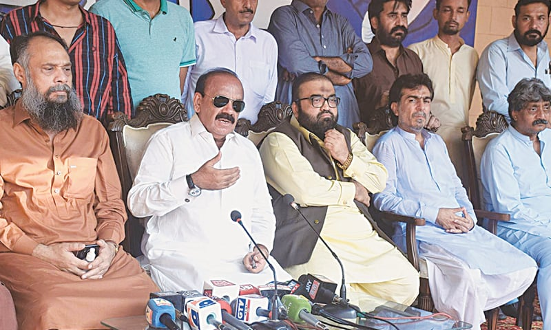 PSP leader Shabbir Ahmed Qaimkhani gestures during his press conference on Monday as others look on. — INP