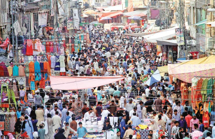 Shoppers gather in Bara Market in Rawalpindi ahead of Eidul Azha. The market will go into lockdown today according to an announcement by the Punjab government. — Photo by Mohammad Asim