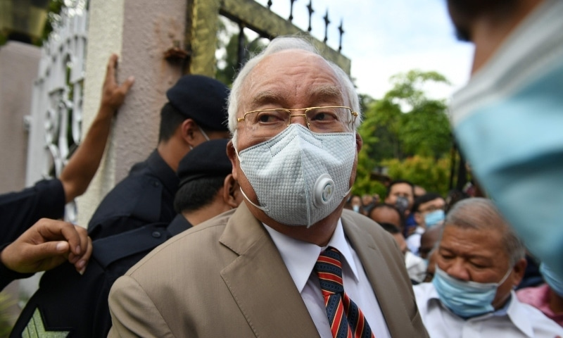 Malaysia's former prime minister Najib Razak rrives at the Duta Court complex awaiting a verdict in his corruption trial in Kuala Lumpur on July 28. —  AFP