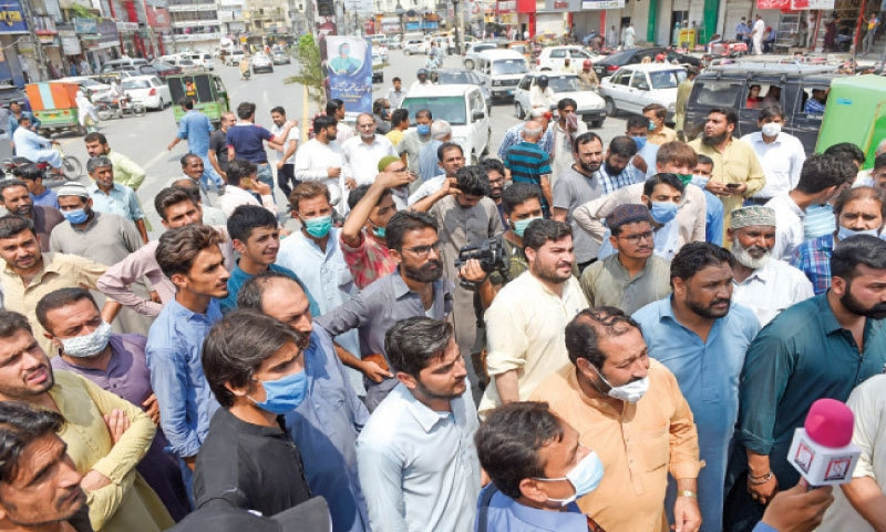 Traders protest against the lockdown in Saddar area of Rawalpindi on Tuesday. — White Star