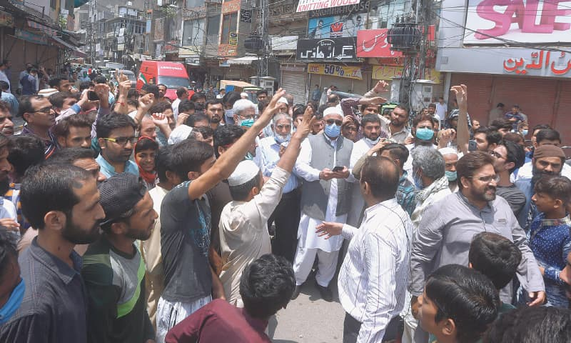 Lahore: Shopkeepers at a market protesting on Tuesday against its closure as they condemn a new lockdown imposed by the provincial government in an effort to contain the spread of Covid-19.—AP