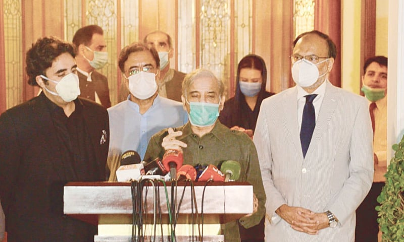 LAHORE: Leader of the Opposition in the National Assembly Shahbaz Sharif talks to media personnel as PPP chairman Bilawal Bhutto-Zardari and Ahsan Iqbal look on.—White Star