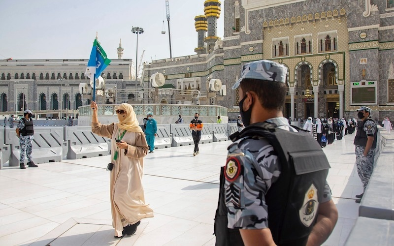 In this photo released by the Saudi Media Ministry, security personnel stand by as a limited numbers of pilgrims arrive, keeping social distancing to limit exposure and the potential transmission of the coronavirus, at the Grand Mosque in Makkah on Wednesday. — via AP