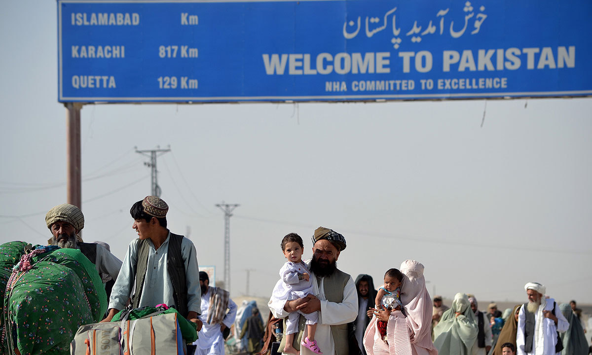 """""""Over 700 Pakistanis and Afghans, including women, children and patients, crossed into Afghanistan and Pakistan,"""" Zakaullah Durrani, a senior official of the Chaman administration said. — Photo by Matiullah Achakzai/File"""