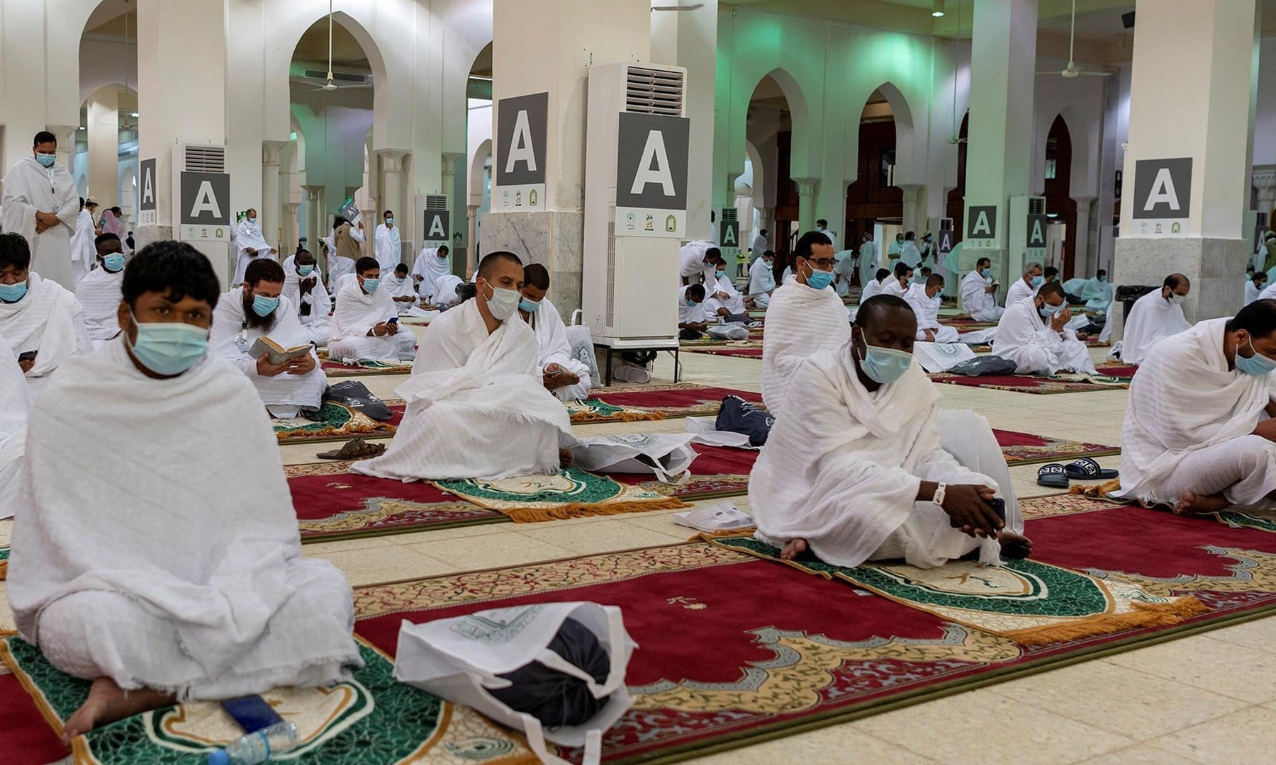 Muslim pilgrims maintain social distancing as they pray inside Namira Mosque in Arafat to mark Haj's most important day on July 30. — Reuters