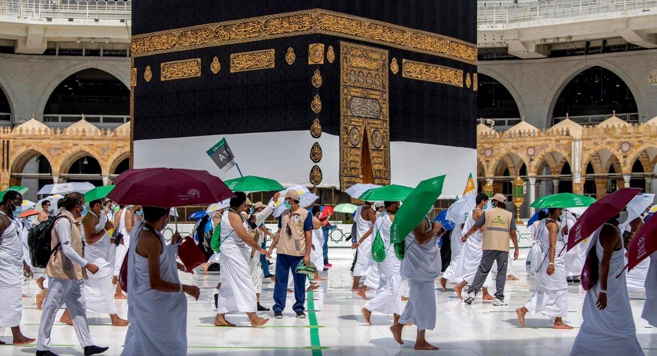 Muslim pilgrims circle the Kaaba at the Grand mosque during the annual Haj pilgrimage on July 29. — Reuters