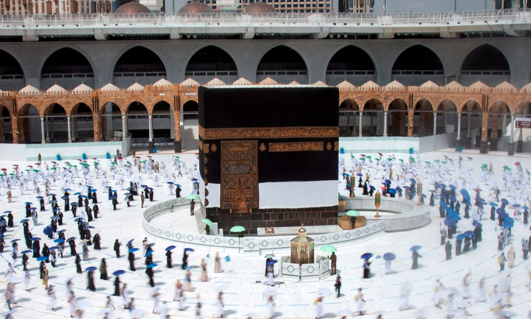 In pictures: Social distancing and electronic wristbands as pilgrims attend scaled-down Haj
