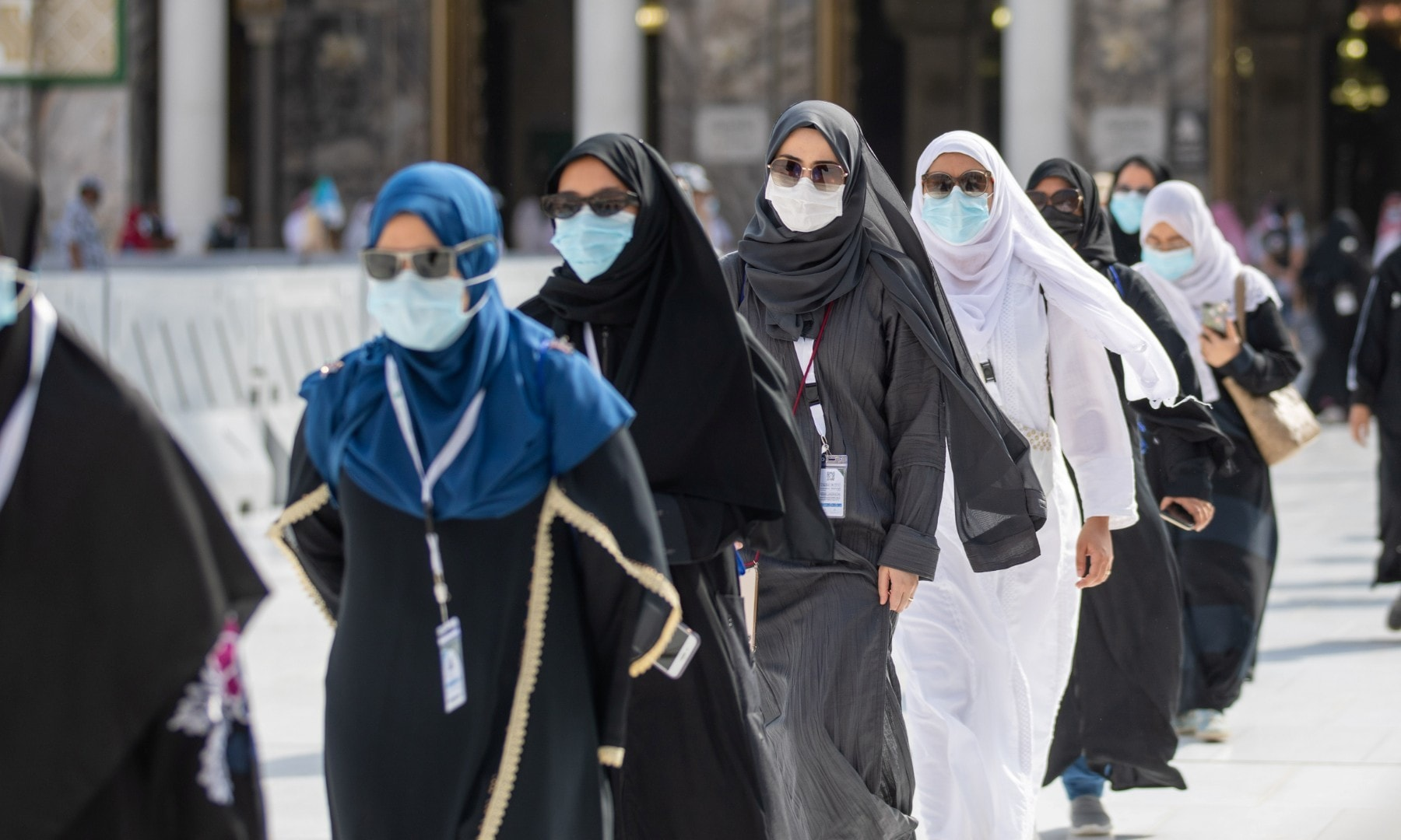 Muslim pilgrims wearing protective face masks arrive to circle the Kaaba at the Grand mosque during the annual Haj pilgrimage on July 29. — Reuters