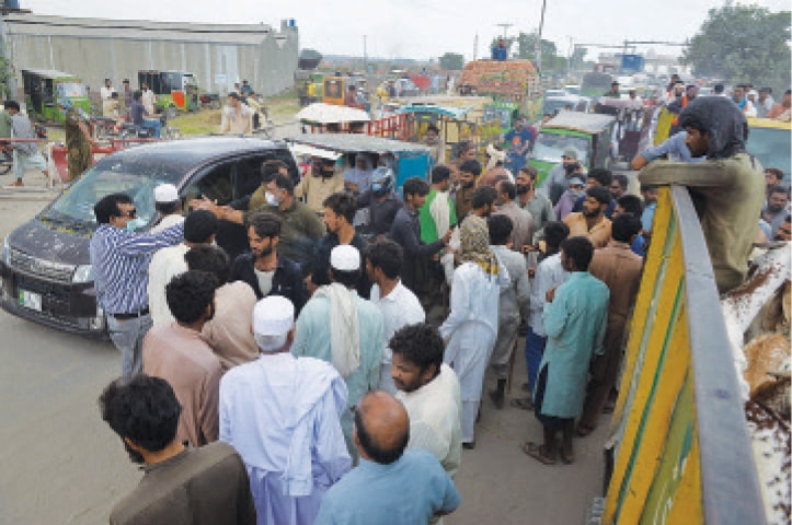 CATTLE traders block the road near Saggian when the city district administration forcibly picked up a number of goats on the pretext of their sale at illegally set up points and for defying standard operating procedures. — White Star / Murtaza Ali