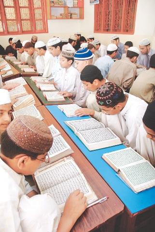 Children read the Quran at a madressah in Karachi | Fahim Siddiqui / White Star