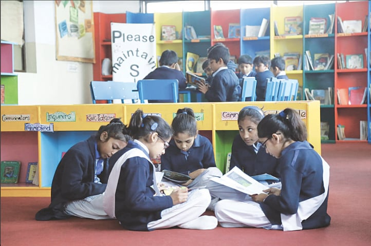 Students read at a library at a school in Lahore | Murtaza Ali / White Star