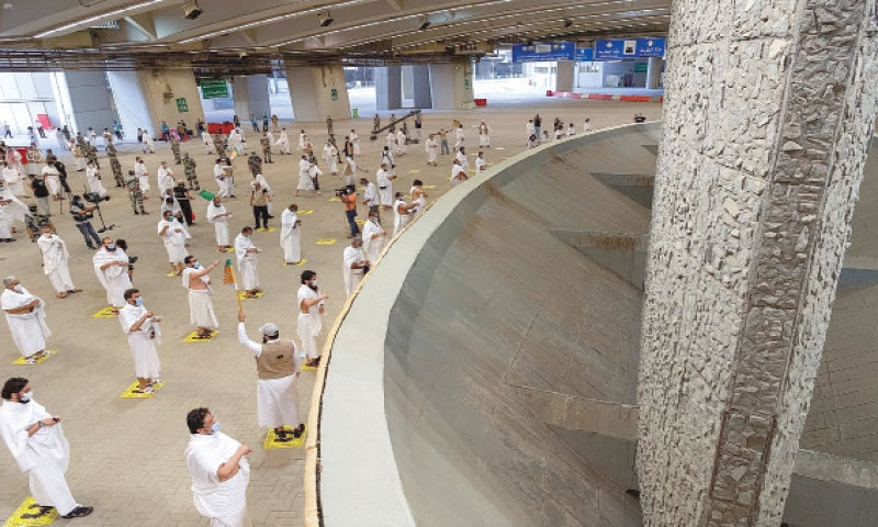 THIS picture provided by the Saudi Press Agency on Friday shows the faithful throwing pebbles at a pillar in the symbolic stoning of the Satan. — AFP
