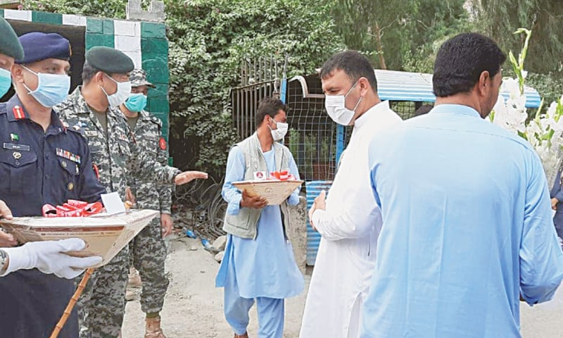 Pakistani officials offering sweets and bouquets to their Afghan counterparts at the Torkham border crossing. Eidul Azha celebration in Afghanistan began on Friday.