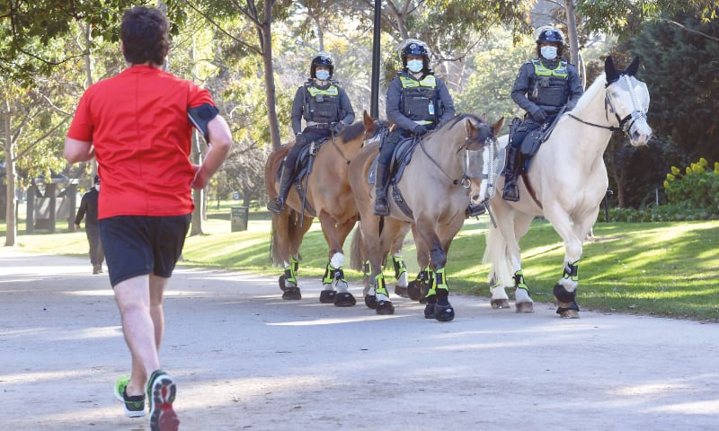 "Melbourne: Police on horseback patrol ""The shrine of remembrance"" while enforcing the wearing of face masks. As greater Melbourne passed the halfway point of a lockdown initially intended to last six weeks, the state of Victoria recorded over 600 new cases on Friday. — AFP"