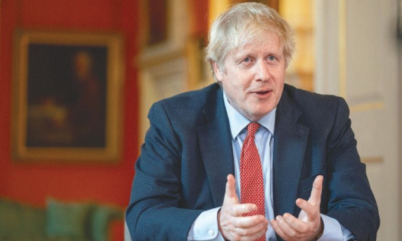 """""""I have said our plan to reopen society and the economy is conditional ... that we would not hesitate to put the brakes on if required. Our assessment is that we should now squeeze that brake pedal,"""" Boris Jonson said. — AFP/File"""