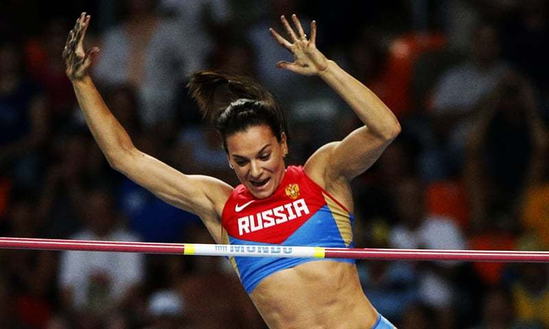 In this file photo, Russia's Yelena Isinbayeva clears the bar to win gold in the women's pole vault final at the World Athletics Championships in the Luzhniki stadium in Moscow, Russia. — AP