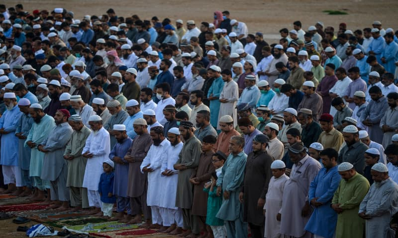 People are seen offering Eidul Azha prayers, without observing precautionary measures, in Karachi on August 1, 2020. — AFP